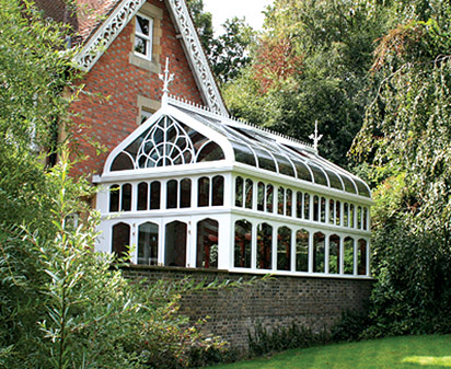Photo of a Gothic conservatory design in keeping with the property it is attached too.